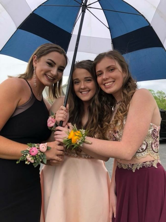 Seniors Ashley Brubaker (guest), Maya Weigard, and Sydney Smith are among the many students who take creative pre-Prom pictures to capture the moment before Prom starts.
