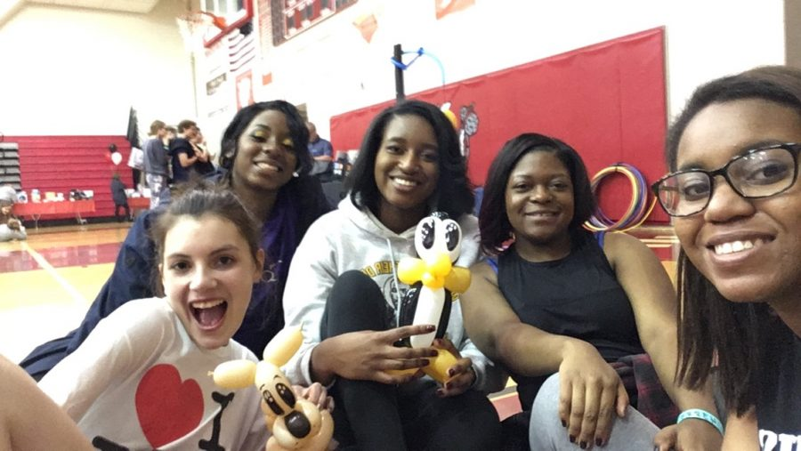Seniors Lizzy Beall, Kendel Abrams, Chiamaka Amadi, Marlana Williams, and Brittany Boone hold their balloon animals near the end of post-Prom.