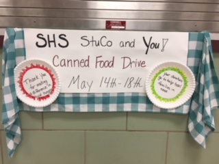 Sign in the gym lobby advertising the food drive.