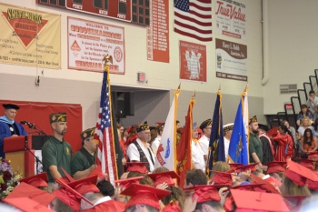 The raising of the flags ceremony done at graduation for the branches of the United States Military.