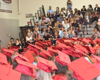 Students standing at graduation.