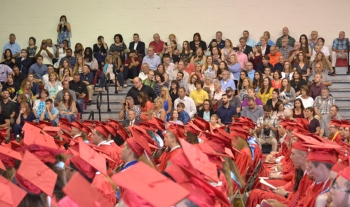 Susky grads seated after walking down the aisle at graduation.