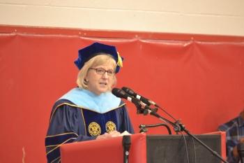 Superintendent Sandra Lemmon giving a heartfelt speech to the soon-to-be graduates.