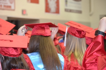 Students moving their tassels from right to left before officially being declared graduates.