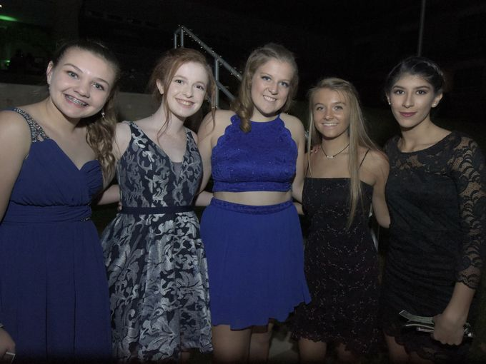Students, Annabelle Gibson, Shannon Porter, Morgan Wright, Sarah Ketterman, and Marci quintanal, arrive at Susquehannock High School in Glen Rock for the school´s homecoming dance, Saturday, October 21, 2017.