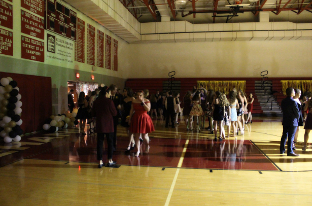 The doors have finally opened, and the gym is set and ready for the long night. Slowly students enter the gym, taking in the lights and greeting their other friends.