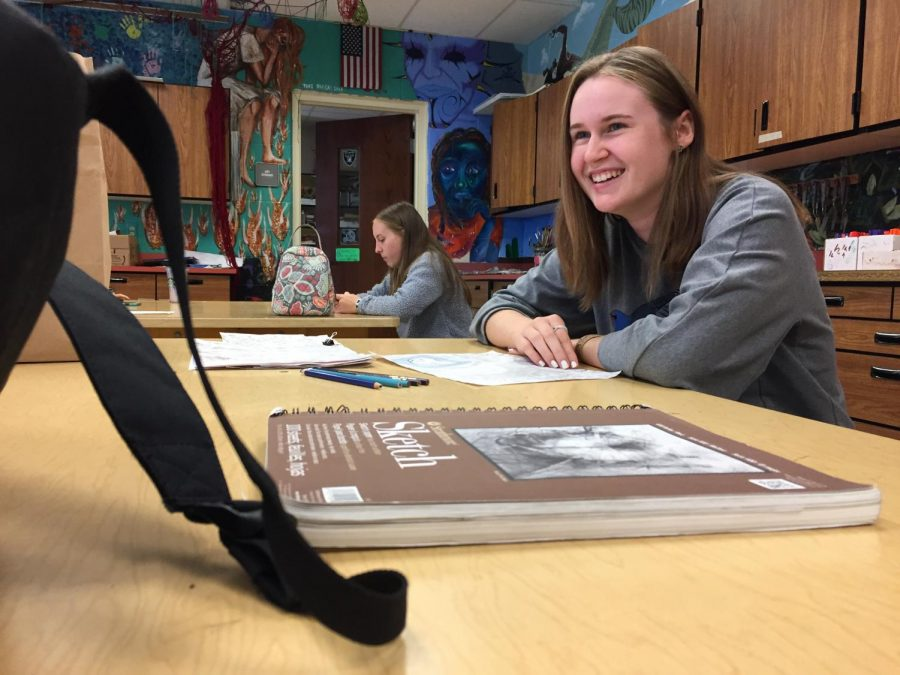 Sormus smiles while talking to her friends in her Drawing I class. Photo by Anna Feild.