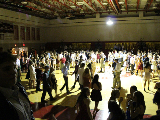 As the fun night continues, more and more students started to get up and dance and talk with their friends. while the music played loud and proud. Some gathered in the lobby outside of the gym to take pictures at the photo booth or to just sit on the couches and talk.