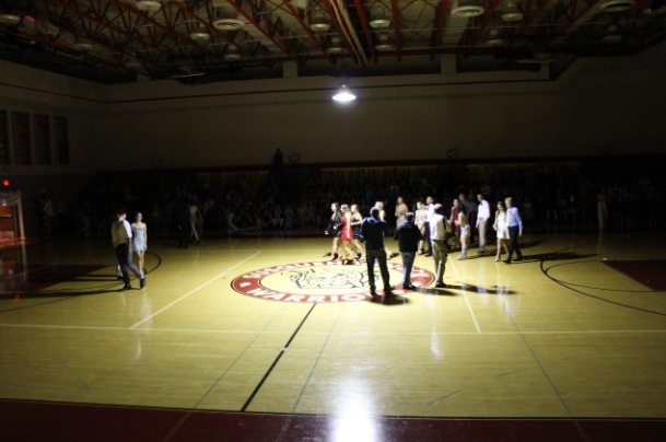 The homecoming court all gathers in the center of the gym for photos from the York Daily Record.