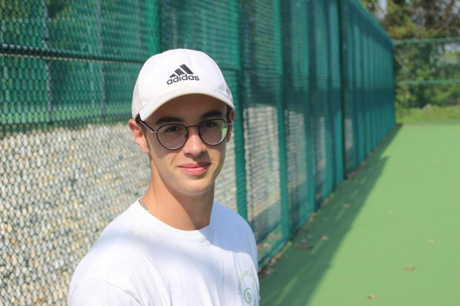 Marin Thomas poses for a picture at the tennis courts. Photo by Michael Daiuto