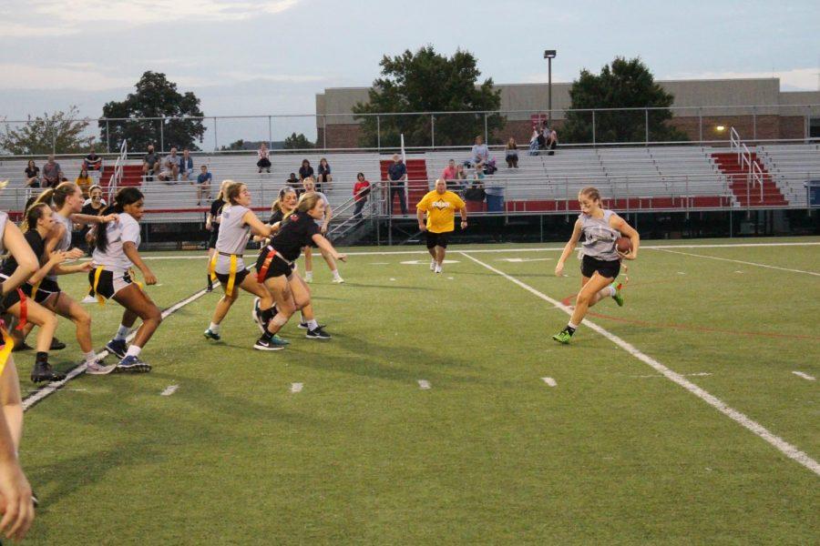 Maddie Marzullo runs with the ball. Photo by Raili Sormus.