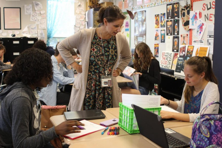 Wilt says that collaboration is an important part of learning. Seniors Mozi Aroworowon and Alexis Bobby work together on the poetry unit in one of Wilt's AP English classes.