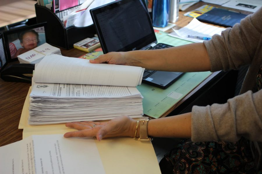 Wilt is the adviser for the National Honor Society.  She goes through 100 or more applications to seek the newest inductees each year. Seen here is the stack of completed applications for the 2018-19 school year.   She usually works on National Honor Society items during her planning period or in the morning when she arrives.