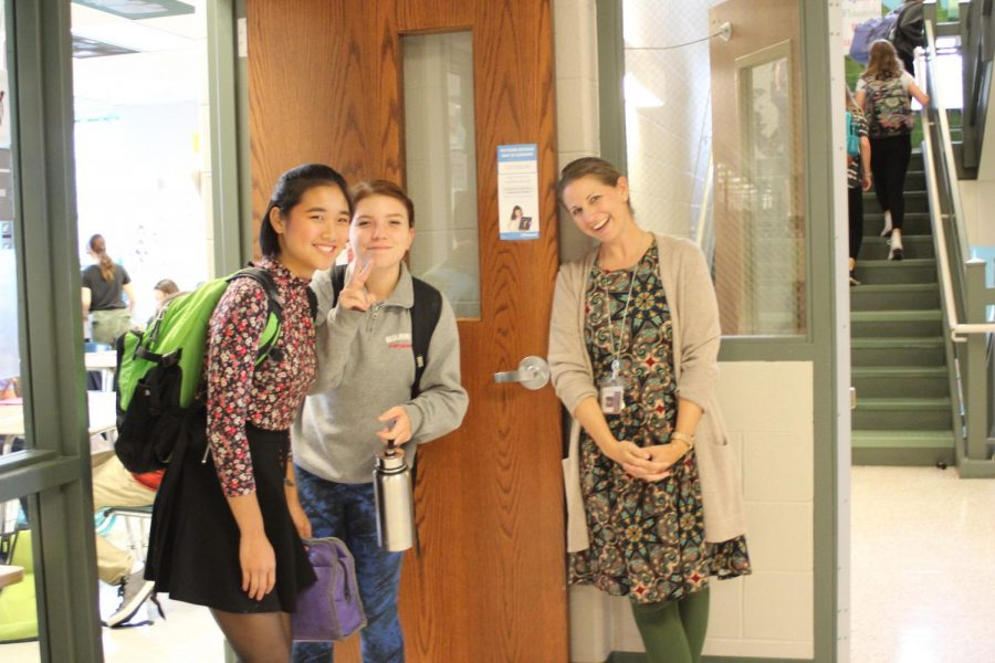 """Wilt always greets her classes at the door with a smile.  Seniors Rachael Scott and Mei Tomko are in her period 9 AP English.  """"She always talks to me,""""   Scott said. """"She's always so upbeat; it makes me happy."""""""