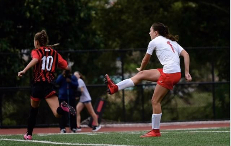 Shelby Derkosh kicking the ball. Photo by Tom Flaherty