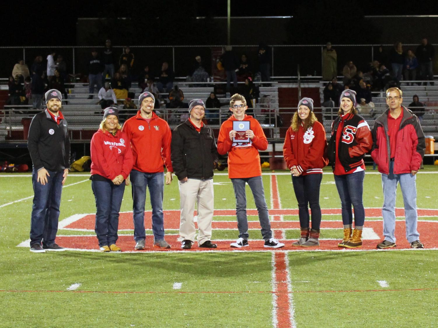 The presentation of the Susquehannock Alumni Association Spirit Award 2018. Pictured from left are Trevor Carrington, Susan Barnhart, Josh Allwine, Mark Rill, Jensen Perry, Anne Bozievich, Sarah Brown, and Jeff Joy.