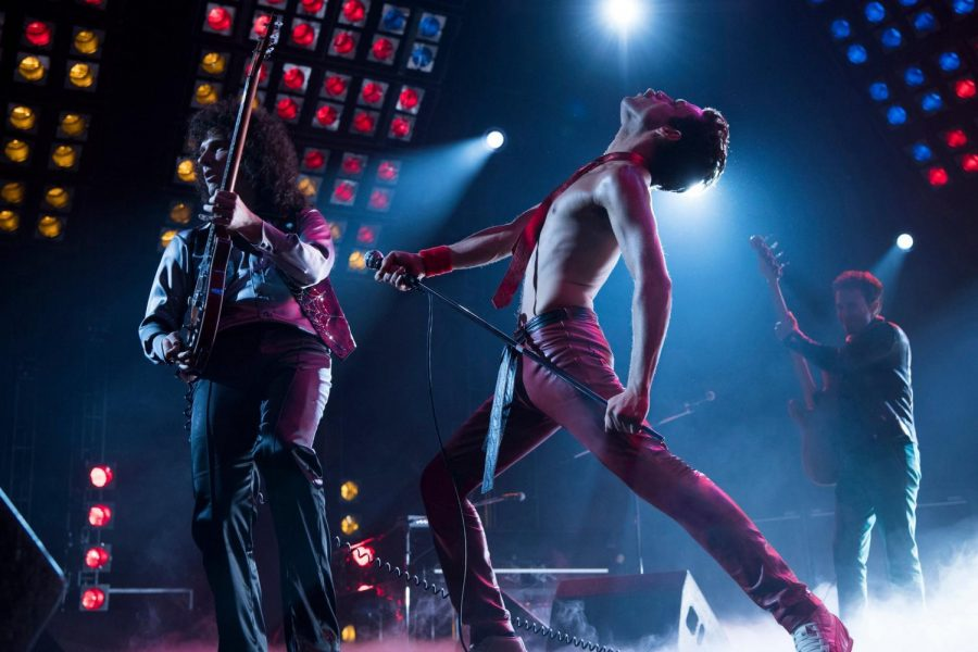 Gwilym Lee(left), Rami Malek(center), and Joe Mazzelo(right) perform in the Queen biopic 'Bohemian Rhapsody