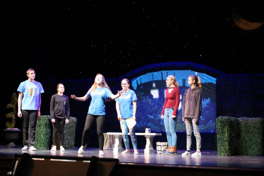 The cast rehearses on stage before their performances of William Shakespeare's
