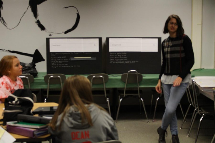 Senior Ally Waltemyer reviews with middle school students about different candidates that running in the 2018 election. Photo by Lucas Dimler