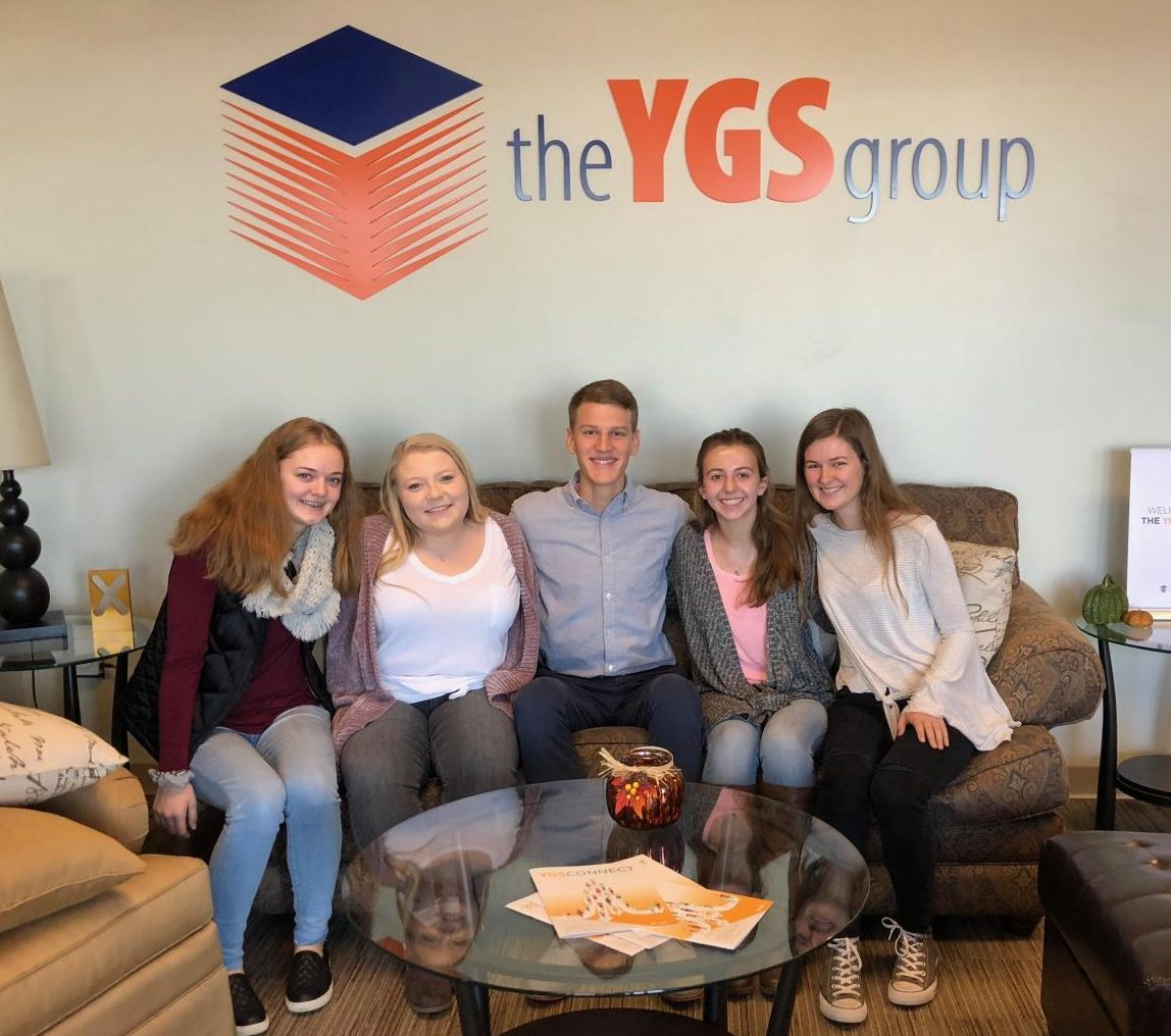 From left to right: junior Caroline Fox, senior Abigail Gallegos, senior Greyson Daviau, junior Emma Robert, and senior Amelia Eyster pose for a group picture in the YGS office.