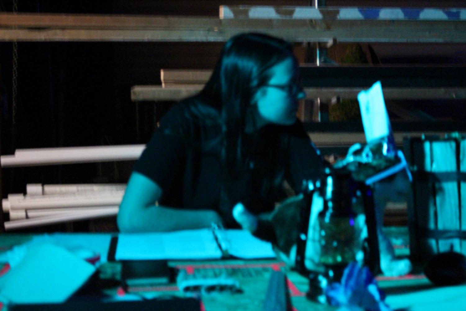 Sophomore+crew+member+Delani+King+watches+over+the+props+backstage.+Pflieger%2C+along+with+the+rest+of+the+cast%2C+appreciate+the+hard+work+crew+put+into+the+show.+%22+I%E2%80%99m+looking+forward+to+showing+everyone+all+the+hard%2C+hard+work+that+we+have+done%2C+because+I+just+want+people+to+be+able+to+appreciate+everything+that+goes+into+theatre.+And...+the+crew+for+being+able+to+put+sets+together+and+organize+lighting+and+sound+which+is+a+really+complicated+process%2C%22+said+Pflieger.+Photo+by+Anna+Feild