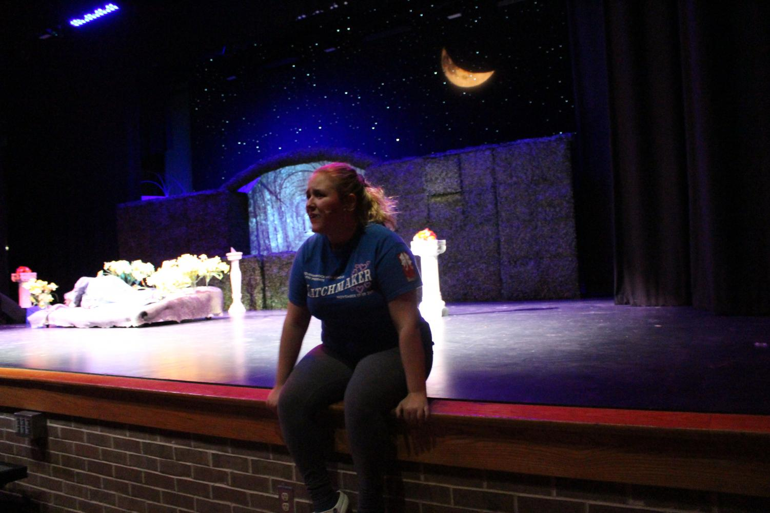 Pflieger+delivers+a+monologue+as+her+character+Helena.+The+cast+were+challenged+in+memorizing+their+lines%2C+but+they+were+eventually+successful.+Pflieger+said%2C+%22Shakespeare%2C+he%E2%80%99s+a+little+wild%3B+he+loves+description...+which+has+led+to+some+trouble+memorizing+lines+because+now+we+have+to+have+the+rhyming+into+effect+too%2C+and+it%E2%80%99s+just+basically+crazy.+It%E2%80%99s+different+than+what+we%E2%80%99ve+done+before+in+terms+of+line+memorization.%22+Photo+by+Anna+Feild