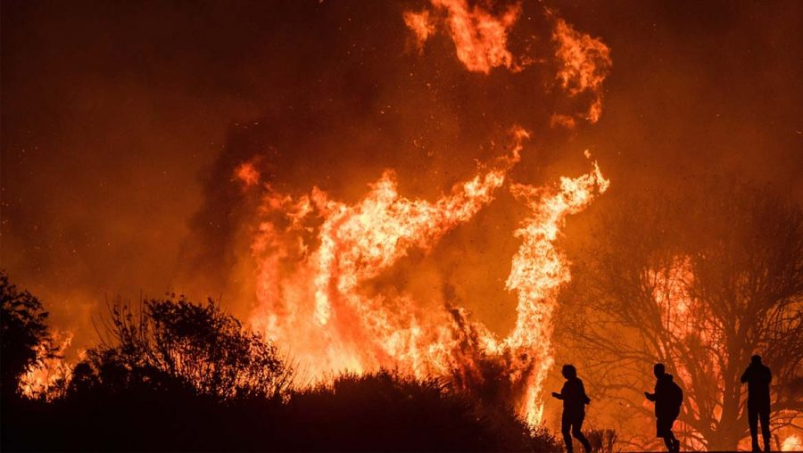This is a photo of firefighters doing what they can to contain a California Wildfire Photo by: Kanak Singh - photographer for https://www.evolving-science.com/environment/california-wildfires-00757