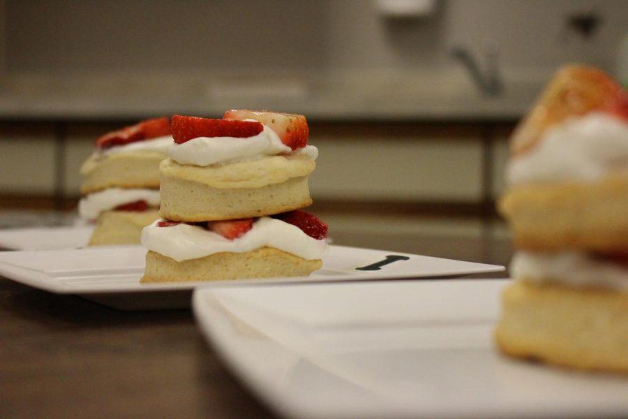 Group one prepares their dessert, strawberry shortcake, for the judges.