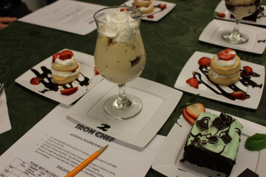 Three desserts are presented to a judge.