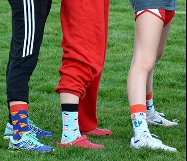 Seniors Leigha Brown, Allison Rodgers and Barbara Barrett pose with their comedic socks - just one example of the team atmosphere of track & field.  Photo courtesy of @_girl_scout_forever_ on Instagram.