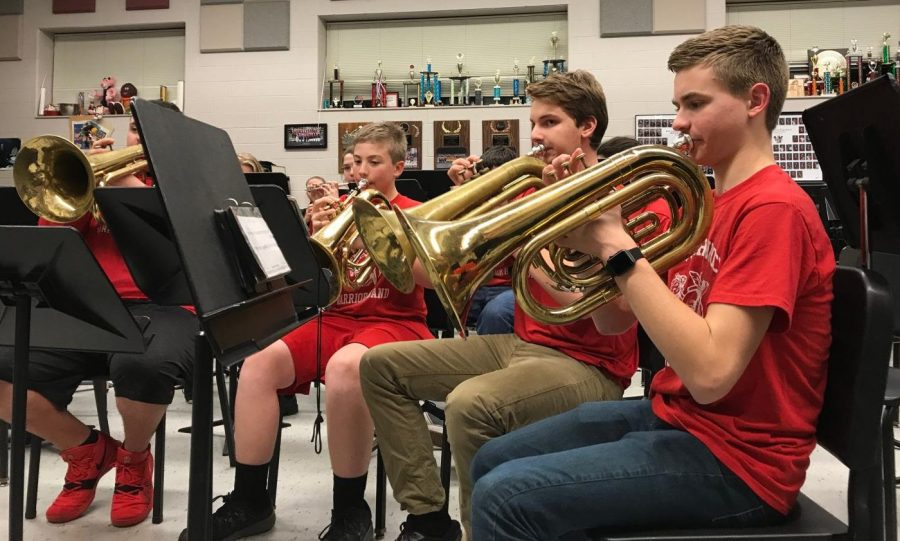 Eighth+grader+Ian+Davis%2C+sophomore+Ian+Pohlig+and+freshman+Alec+Warner+rehearse+music+during+the+group%E2%80%99s+first+meeting+of+the+year.+Students+in+pep+band+come+together+in+order+to+perform+for+girls+and+boys+home+basketball+games.+Photograph+by+Camryn+Brakmann