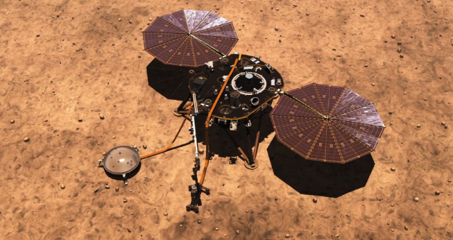 An overhead shot of the InSight system on Mars