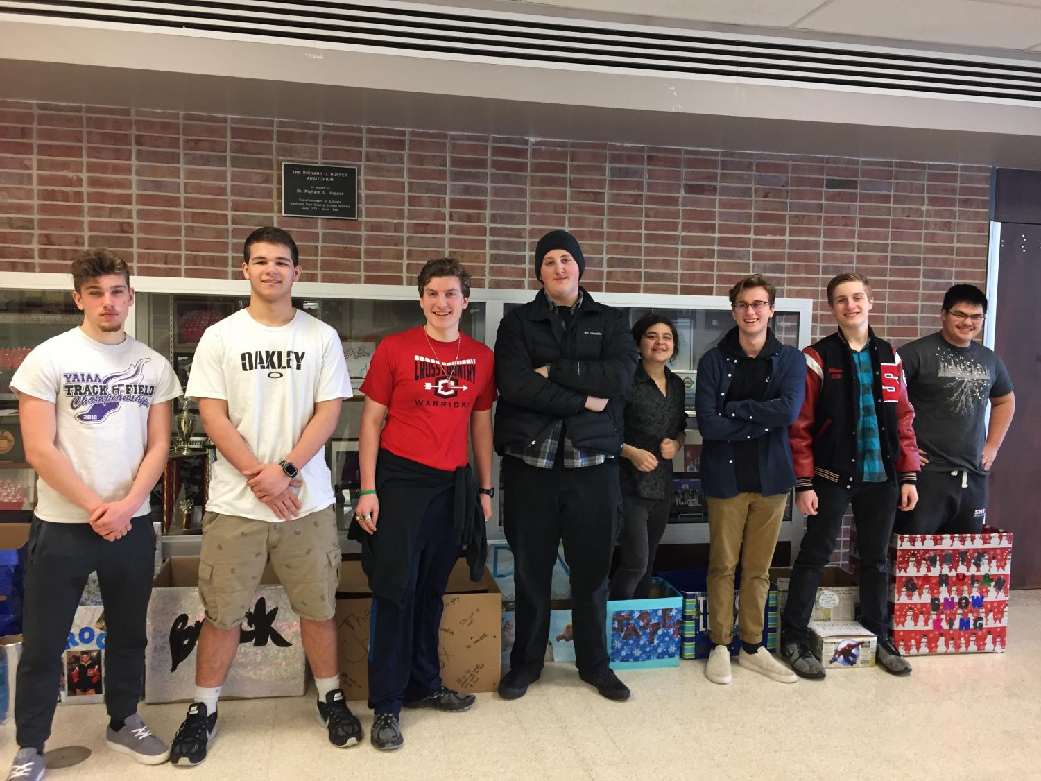 There are twelve candidates for Snow King - six juniors and six seniors. From left to right: Cody McCredie, Brock Hofler, Christian Collins, Dan Poole, Jasper Rowe, Trevor Leuba, Shane Watson and Garrian Phanthy. Not pictured: Michael Boampong, Connor Kernan, Henry Rohlfs and Nolan Holloway. Photo by Anna Feild