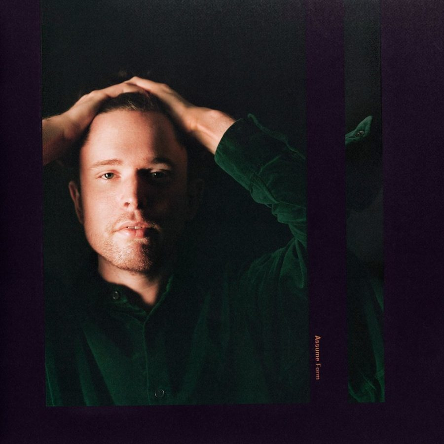 James Blake poses on the cover of his new album