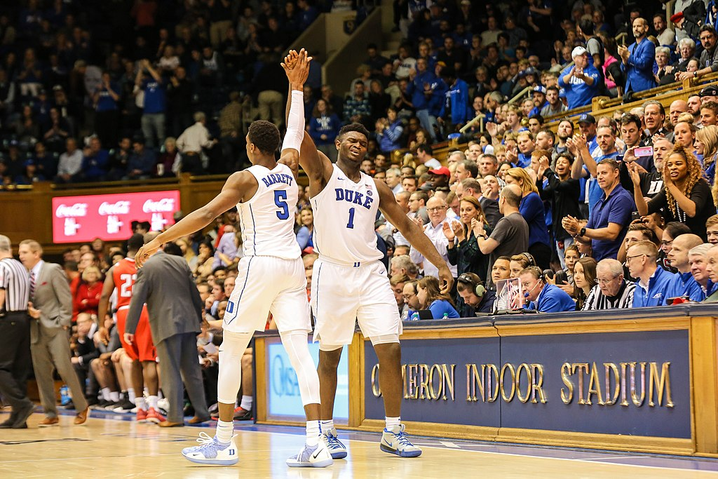 Freshmen Zion Williamson and R.J. Barrett celebrating after a timeout.  Photo by Keenan Hairston via Wikimedia Commons