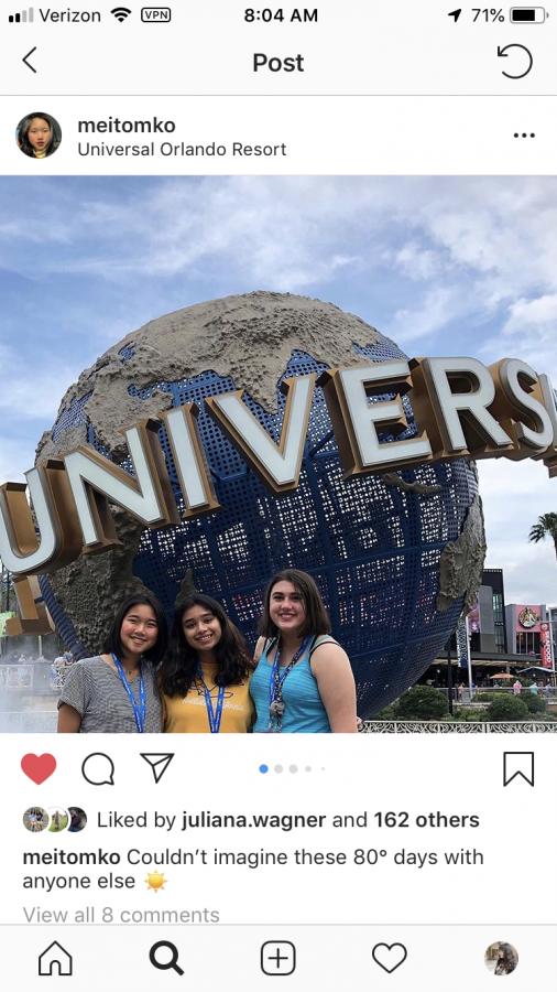 Seniors Mei Tomko and Bryanna Stimmel and Freshman Aneesha Kandala pose in front of the Universal Studio logo.