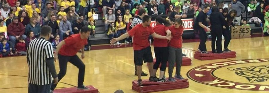 Team members scurried to get to the other side of the gym on mats. Photograph by Lili Teal