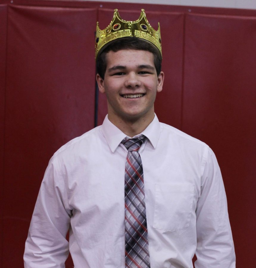 Hofler smiling for his picture after being crowned snow king. Photo by Emily Ditt