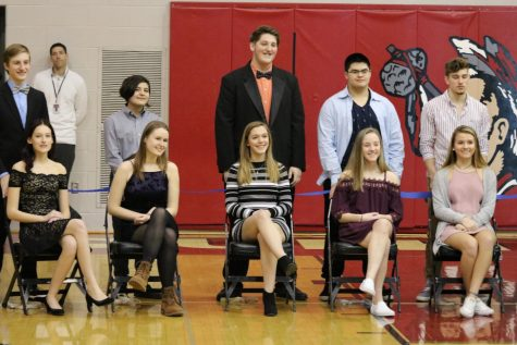 Pairs wait to see who will get crowned. From top row left to right, bottom row left to right: senior Shane Watson, senior Jasper Rowe, senior Dan Poole, junior Garrian Phanhthy, junior Cody McCredie, senior Cora Dunaja, senior Raili Sormus, junior Hannah Adler, junior Maddy Yoakum, and junior Sarah Ketterman. The Snow King competition is hosted by the Mini-THON club at Susquehannock. Boys from the senior and juniors classes, compete to see who can raise the most money or collect the most canned goods. Each boy places a large decorated cardboard box in the auditorium lobby and anyone from the student body can donate to who they wish. These boys also gather monetary donations that will go towards Mini-THON. Photo by Alex Martuszewski.