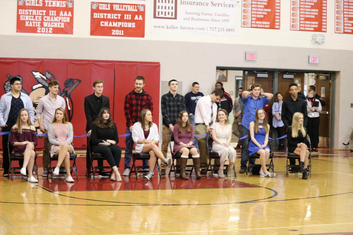 Candidates are introduced to the student body. From top row left to right, bottom row left to right: senior Trevor Leuba, junior Connor Kernan, junior Nolan Holloway, junior Brock Hofler, senior Christian Collins, senior Michael Boampong, senior Mia Kobylski, senior Ali Krahl, junior Emma Robert, junior Holly Mullaney, senior Megan Watkins, and junior Katie Mauldin. Photo by Alex Martuszewski.
