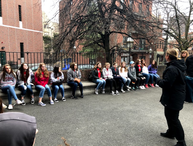 Students listen to a tour guide speak at Paul Revere's house while on a city tour. Photo by Andrew Kalmanowicz