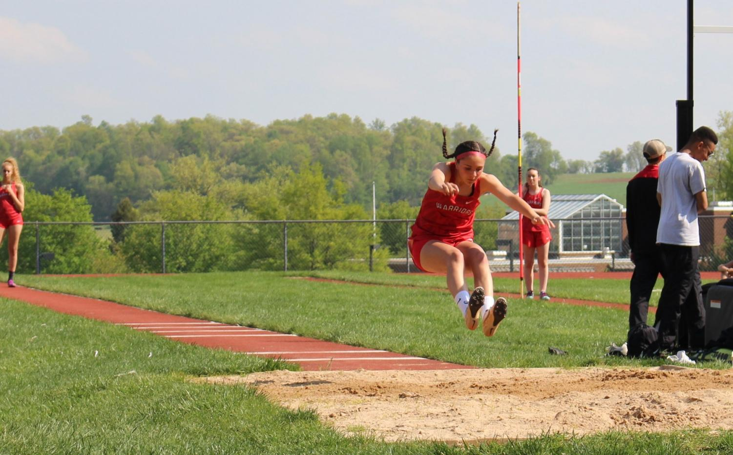 Freshman+Shelby+Derkosh+competes+in+the+long+jump.+Derkosh+took+first+place+in+the+long+jump%2C+triple+jump+and+400m+race+in+the+Kennard-Dale+meet.