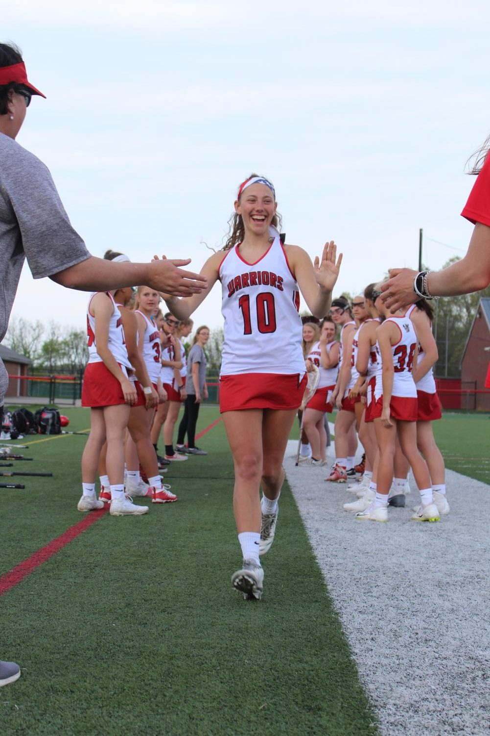 Senior+Abby+Grim+gets+announced+as+a+starter+prior+to+the+start+of+the+Dover+game.+Before+each+home+game%2C+the+starting+lineup+is+announced+and+each+girl+gets+to+run+through+their+teammates+and+high+five+their+coaches.+Grim+will+be+attending+Penn+State+in+the+fall+to+major+in+elementary+education.+Photograph+by+Stephanie+Graffin