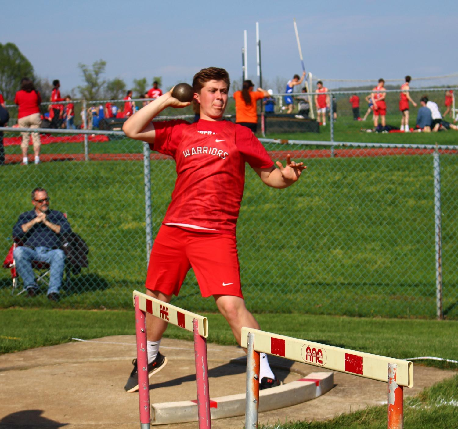 Freshman+Sam+Elsen+throws+the+shot+put+in+the+Kennard-Dale+meet.+%E2%80%9CI+thought+it+went+really+well%2C+I+thought+everyone+was+really+nice.+They+helped+me+improve.%E2%80%9D+said+Elsen+on+how+his+first+year+of+high+school+track+went.+
