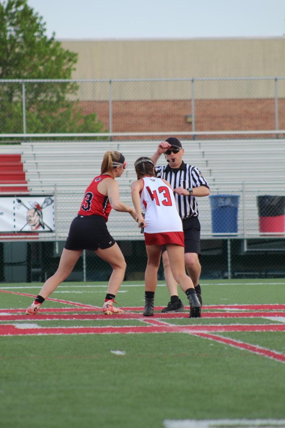 Sophomore+Ariana+Prediger+watches+the+ref+waiting+for+the+whistle+to+take+the+draw.+Prediger+or+another+close+teammate+will+catch+the+ball+and+run+it+down+to+the+field+to+set+up+a+scoring+play.+Photograph+by+Stephanie