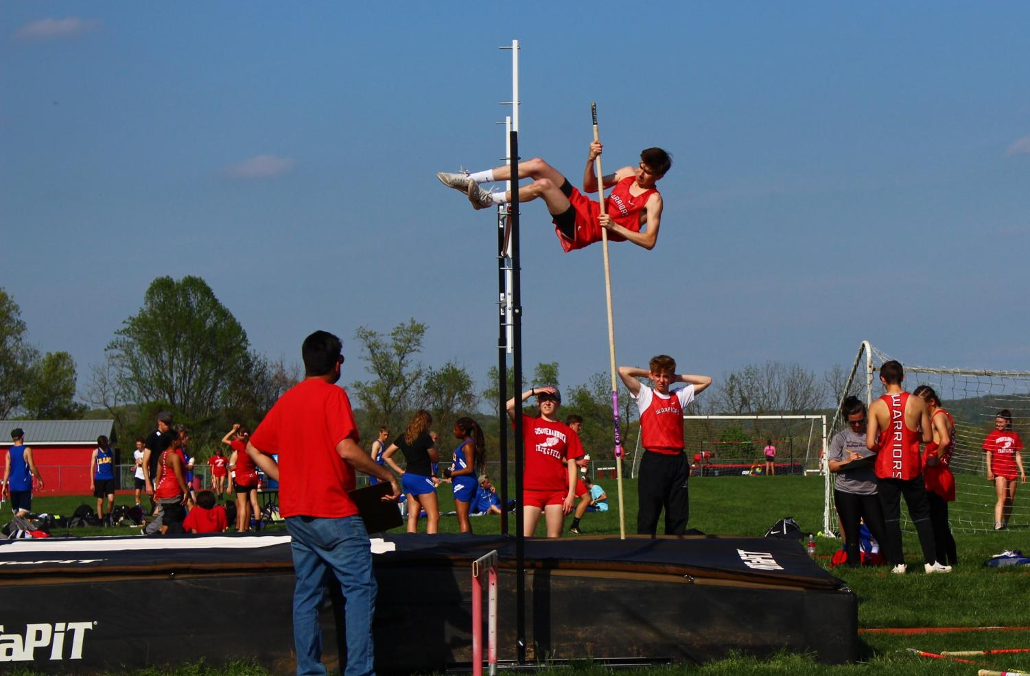 Junior+Duncan+McQuay+competes+in+the+pole+vault+in+the+meet+against+Kennard-Dale.+%0ASenior+Michael+Boampong+won+the+pole+vault+competition+in+the+meet+with+Kennard-Dale+with+a+jump+of+12%273%22.