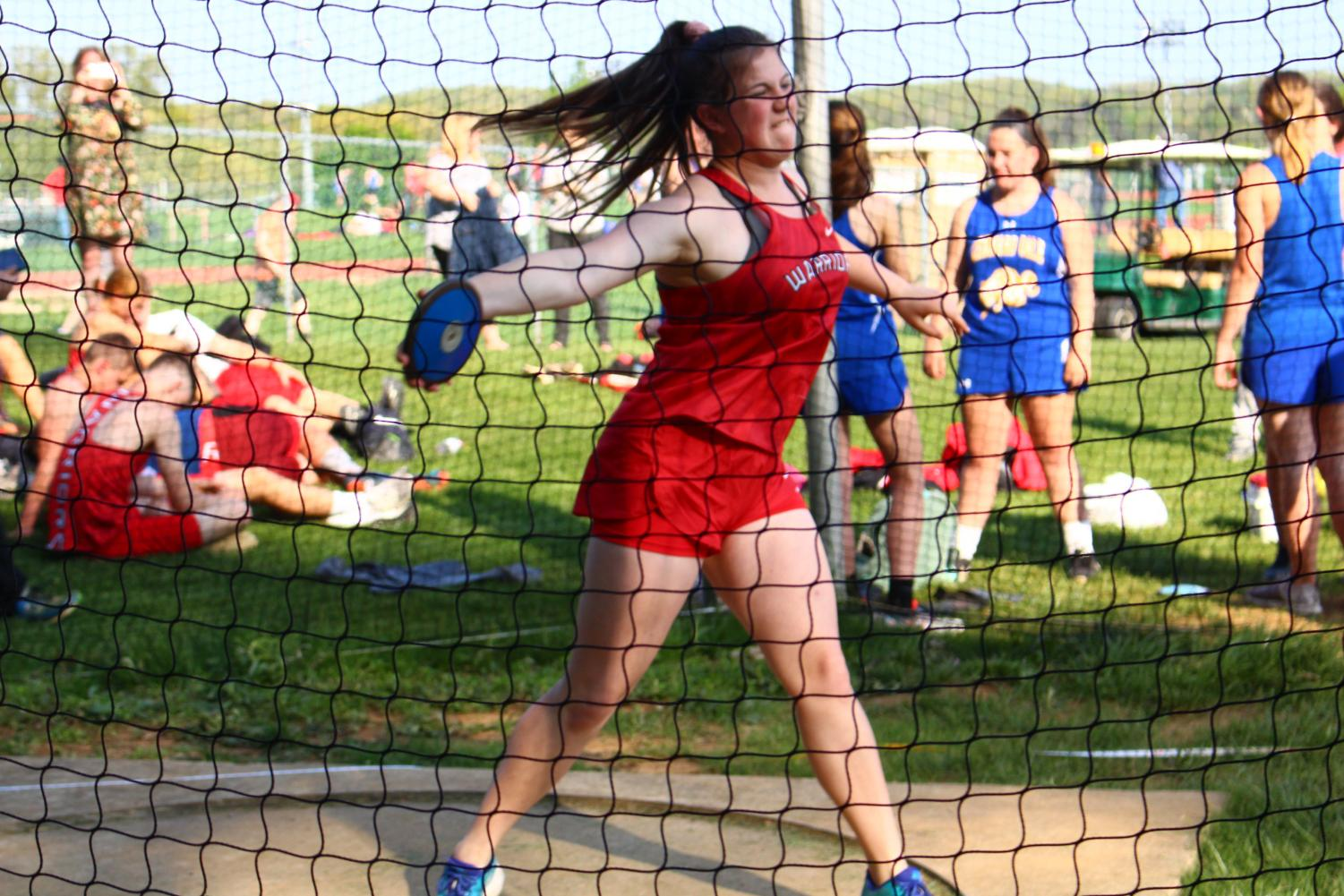 Freshman+Andrea+Hammond+throws+the+discus+in+the+Kennard-Dale+meet.+Hammond+finished+in+second+place+with+a+distance+of+64%27+10%22.+She+placed+first+in+the+shot+put+with+a+distance+of+29%27+10%22.+For+the+season%2C+the+boys+track+and+field+team+finished+with+a+regular+season+record+of+5-2%2C+while+the+girls+went+6-1.+