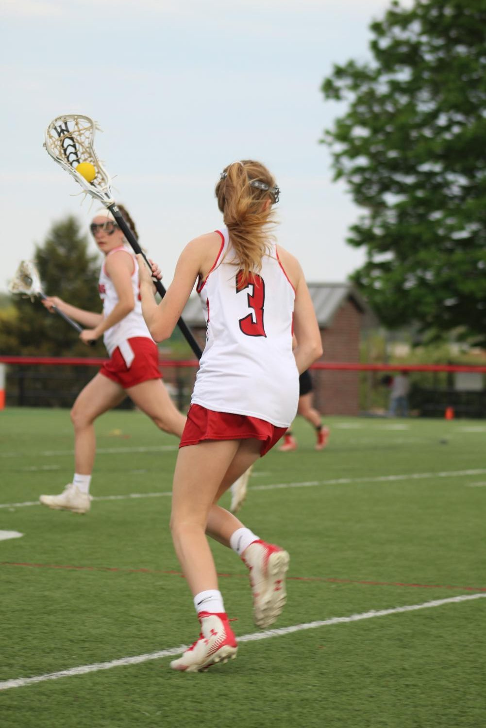 Freshman+Addison+Roeder+carries+the+ball+down+the+field+looking+to+set+up+a+scoring+play.++Roeder+ended+the+game+with+two+goals+and+two+assists.+Photograph+by+Stephanie+Graffin