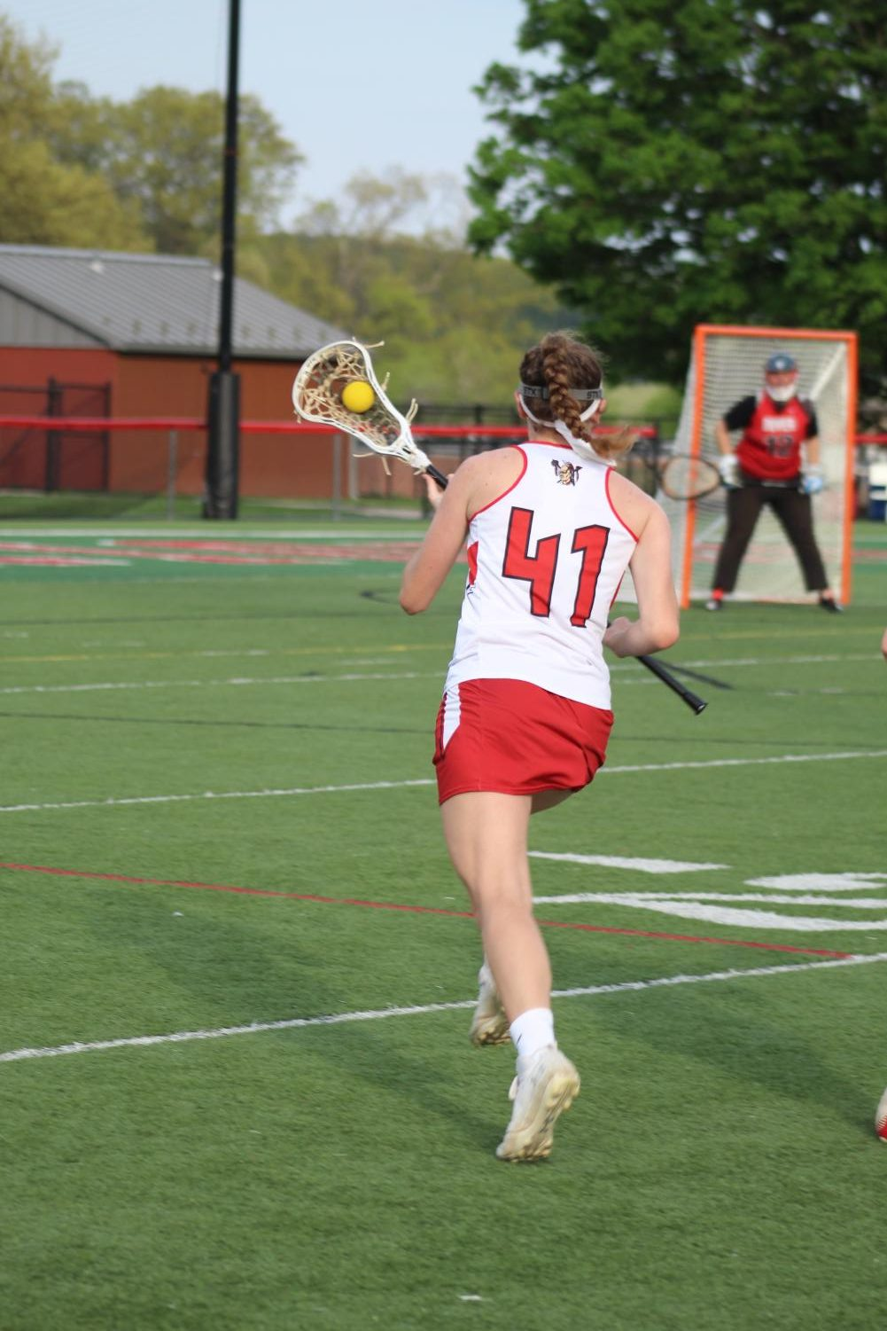 Sophomore+Rachel+Oestrike+runs+the+ball+down+the+sideline+to+get+close+enough+to+take+a+shot.+Oestrike+was+chosen+for+a+second+team+attacker+for+the+YAIAA+girls+lacrosse+all-star+team.+Photograph+by+Stephanie+Graffin