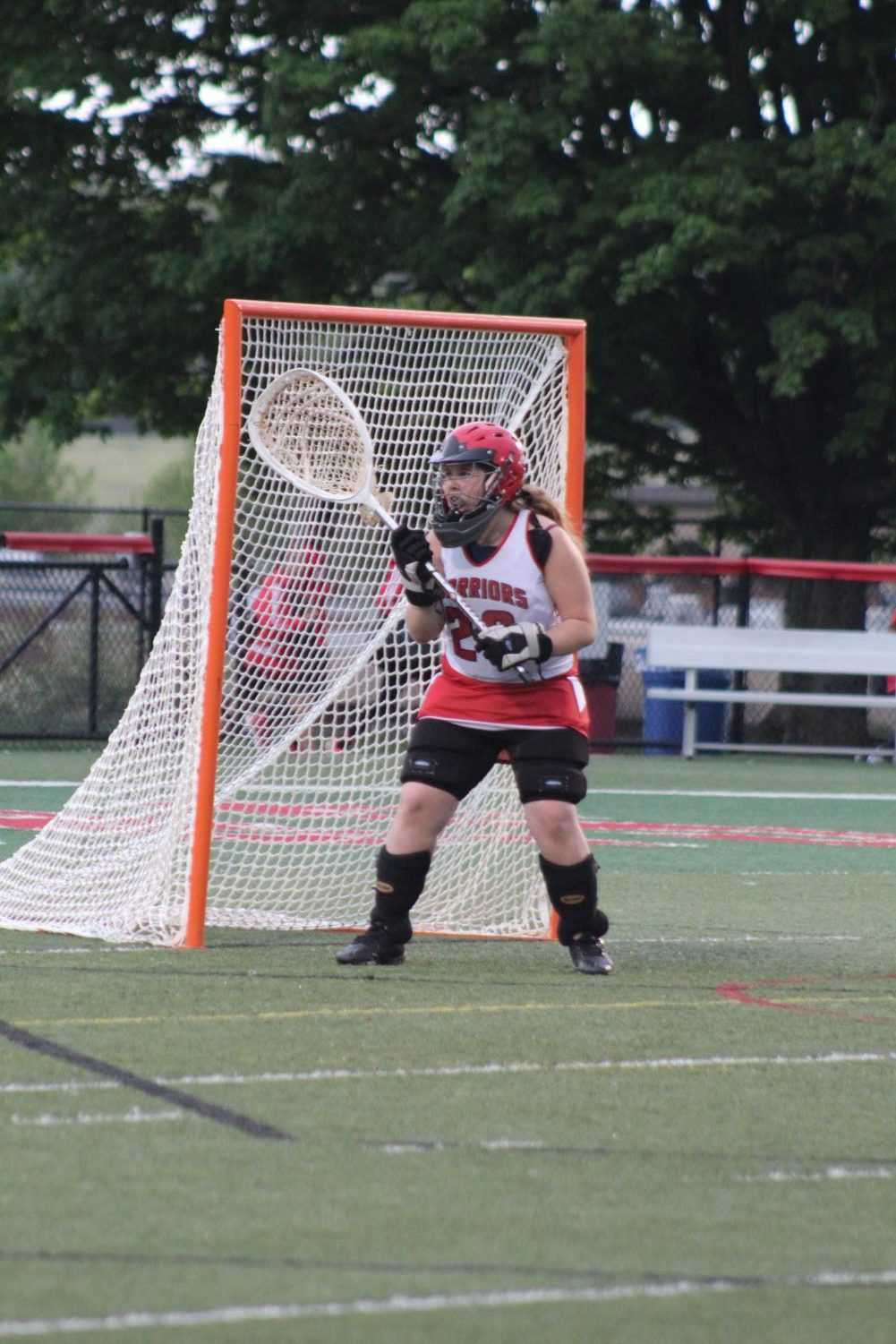 Junior+JV+goalie+Caitlyn+Keener%2C+with+eyes+on+the+ball%2C+is+ready+for+the+opposing+attacker+to+take+a+shot.+Keener+went+into+the+game+in+the+second+half+when+the+warriors+were+up+by+double-digit+points.+The+Lady+Warriors+beat+Dover+18-4.%0APhotograph+by+Stephanie+Graffin